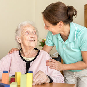 Caregiver with memory-care patient